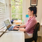 Barefoot Physiotherapy Brisbane example of An example of correct sitting posture at a desk with added support on your back using a towel.
